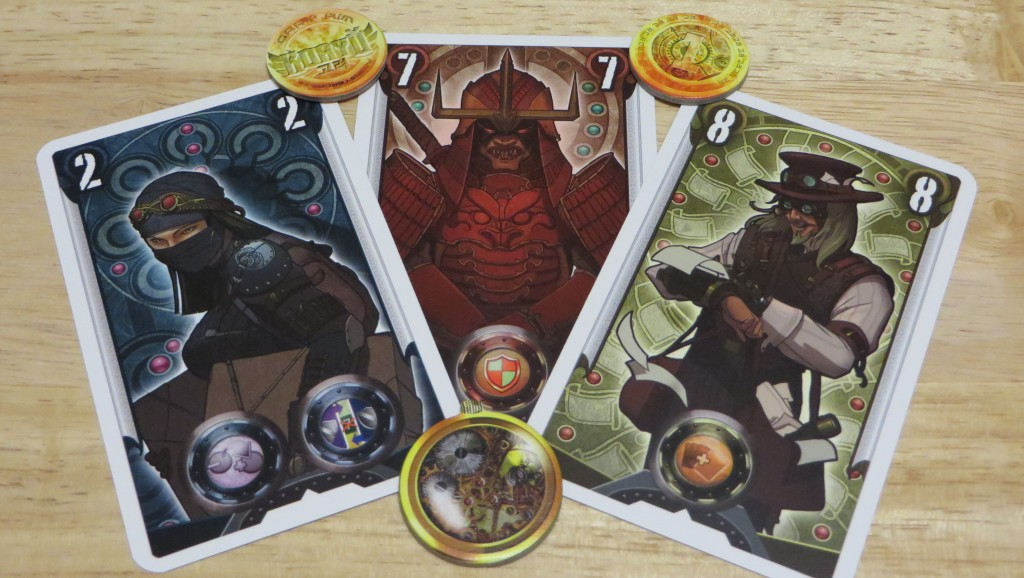 The Spy, Guardian, and Broadcaster cards with the initiative token [bottom] and victory tokens. - Koryo