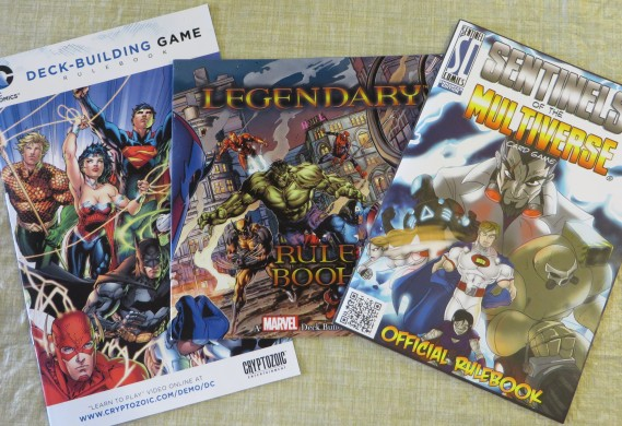 Rulebooks for DC Deckbuilding Game, Legendary, and Sentinels of the Multiverse